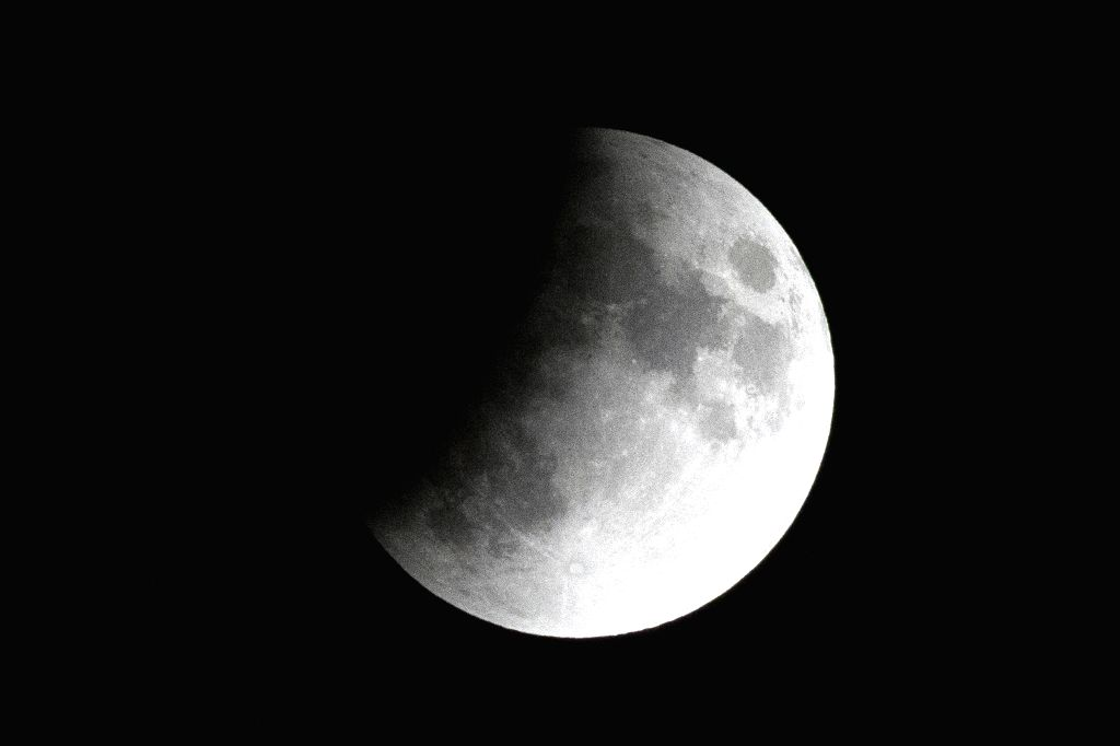 CAIRO, July 16, 2019 - A partial lunar eclipse is seen in Cairo, Egypt, on July 16, 2019.