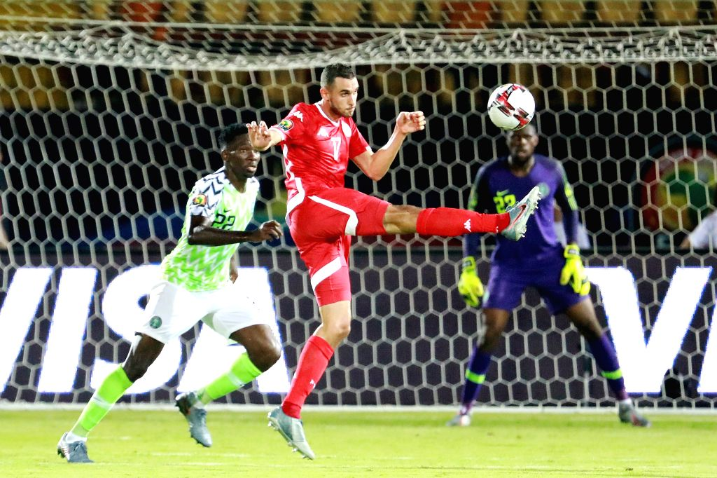 CAIRO, July 18, 2019 - Ellyes Joris Skhiri (front R) of Tunisia vies for the ball during the third place final against Nigeria at the 2019 Africa Cup of Nations in Cairo, Egypt, July 17, 2019.