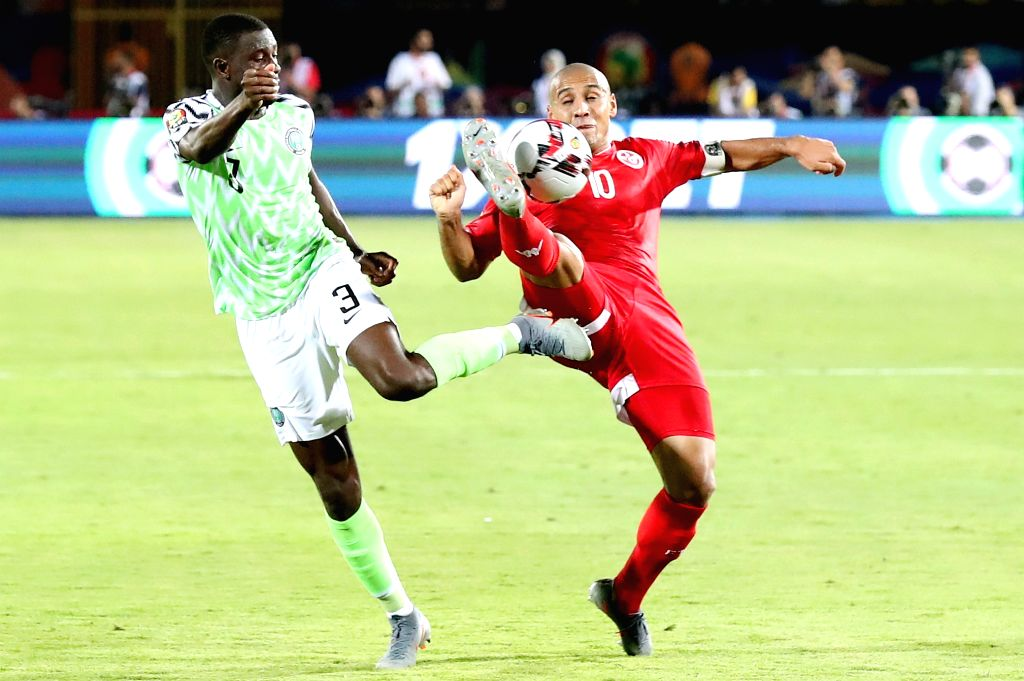 CAIRO, July 18, 2019 - Jamilu Collins (L) of Nigeria vies with Wahbi Khazri of Tunisia during the third place final at the 2019 Africa Cup of Nations in Cairo, Egypt, July 17, 2019.