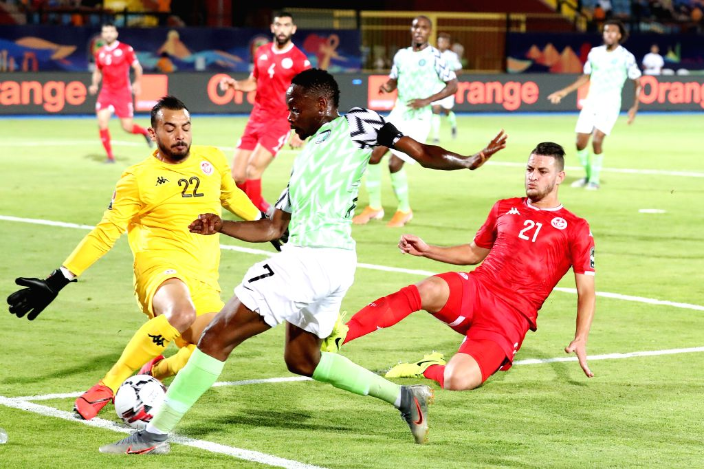 CAIRO, July 18, 2019 - Nigeria's Ahmed Musa (C) vies with Tunisia's goalkeeper Moez Ben Cherifia during the third place final at the 2019 Africa Cup of Nations in Cairo, Egypt, July 17, 2019.