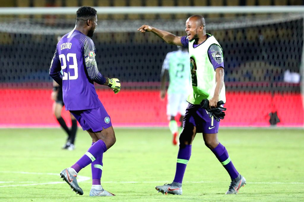 CAIRO, July 18, 2019 - Nigeria's goalkeeper Francis Odinaka Uzoho (L) and Ikechukwu Vincent Ezenwa celebrate after winning the third place final against Tunisia at the 2019 Africa Cup of Nations in ...
