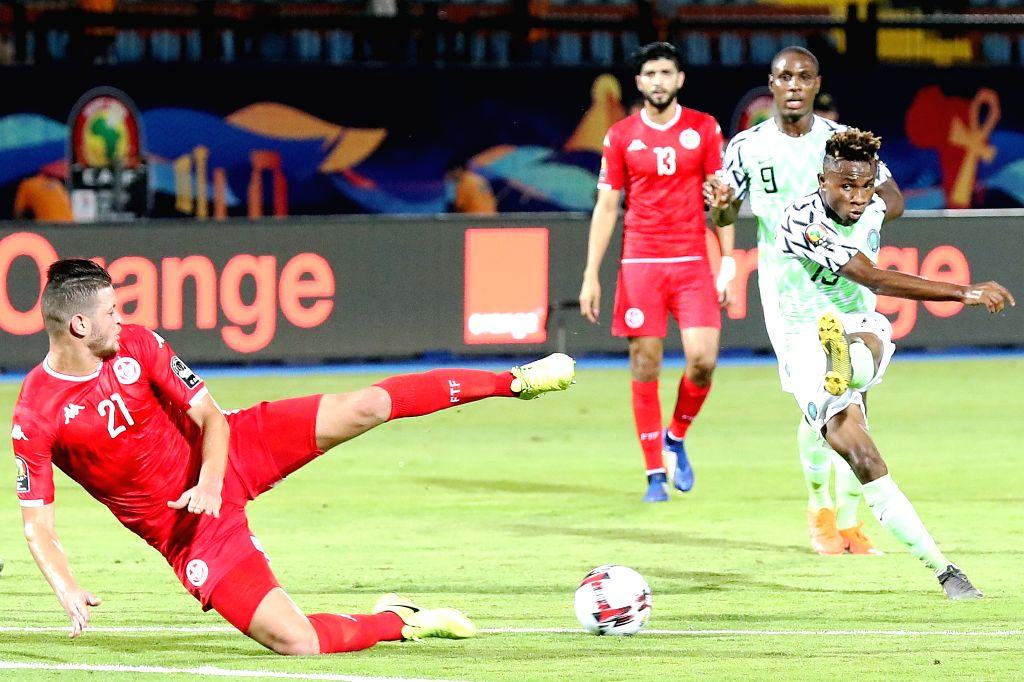 CAIRO, July 18, 2019 - Samuel Chimerenka Chukwueze (R) of Nigeria shoots during the third place final against Tunisia at the 2019 Africa Cup of Nations in Cairo, Egypt, July 17, 2019.
