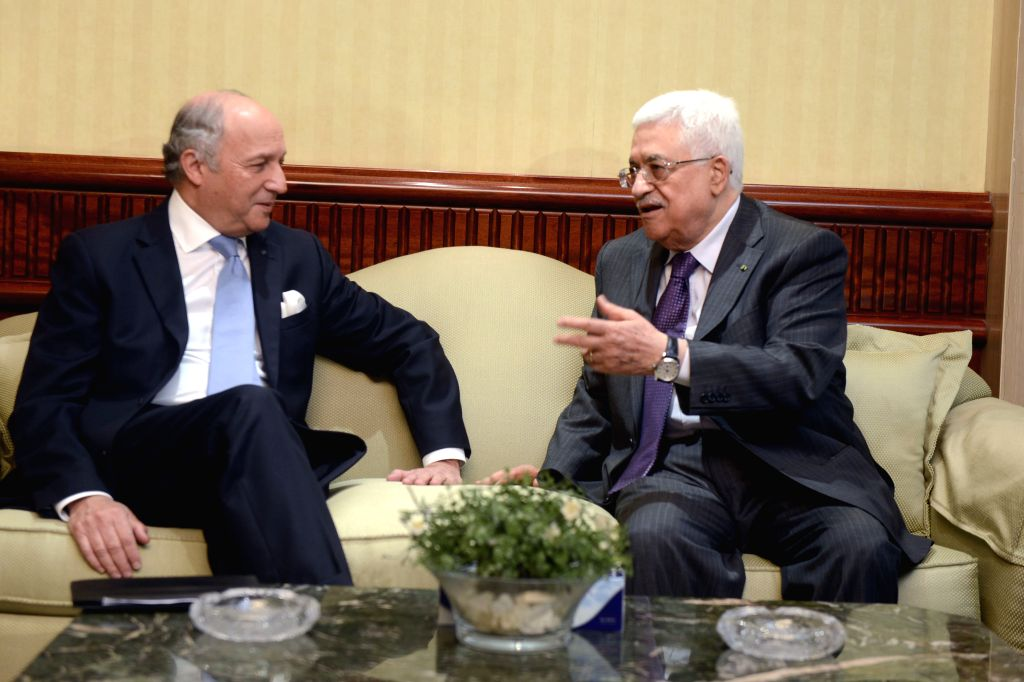 Palestinian President Mahmoud Abbas (R) meets with French Foreign Minister Laurent Fabius in Cairo, Egypt, July 18, 2014. Palestinian President Mahmoud Abbas ...