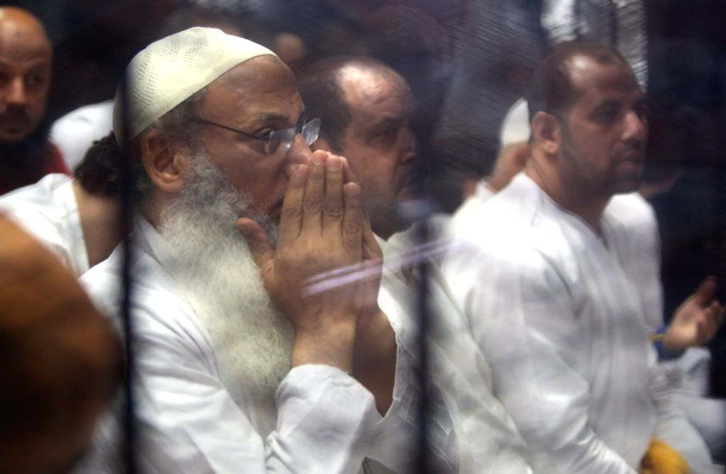 CAIRO, July 2, 2017 - Defendants are seen in a cage during their trial in Cairo, Egypt on July 2, 2017. An Egyptian court sentenced on Sunday 20 people to death over charges of murdering 12 police ...