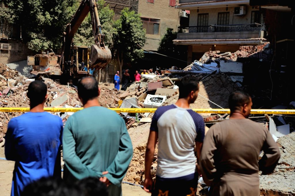 CAIRO, July 2, 2018 - People are seen at the building collapse site in the Shobra borough in Cairo, Egypt, on July 2, 2018. Two buildings collapsed in Cairo on Monday.