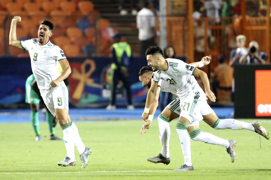 CAIRO, July 20, 2019 - Baghdad Bounedjah (1st L) of Algeria celebrates after scoring during the 2019 Africa Cup of Nations final match between Senegal and Algeria in Cairo, Egypt on July 19, 2019. ...