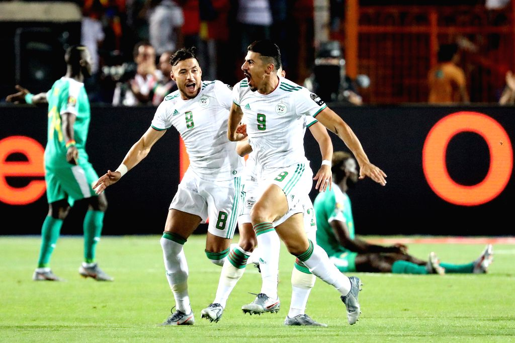 CAIRO, July 20, 2019 - Baghdad Bounedjah (front) of Algeria celebrates after scoring during the 2019 Africa Cup of Nations final match between Senegal and Algeria in Cairo, Egypt on July 19, 2019. ...