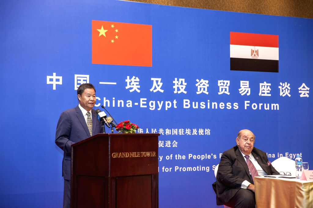 CAIRO, July 28, 2019 - Chairman of China's Council for promoting South-South Cooperation (CPSSC) Lyu Xinhua (L) speaks during the China-Egypt Business Forum in Cairo, Egypt, on July 28, 2019. China's ...