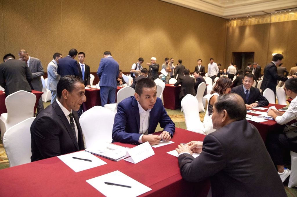 CAIRO, July 28, 2019 - People communicate at the China-Egypt Business Forum in Cairo, Egypt, on July 28, 2019. China's Council for Promoting South-South Cooperation (CPSSC) seeks to explore trade and ...