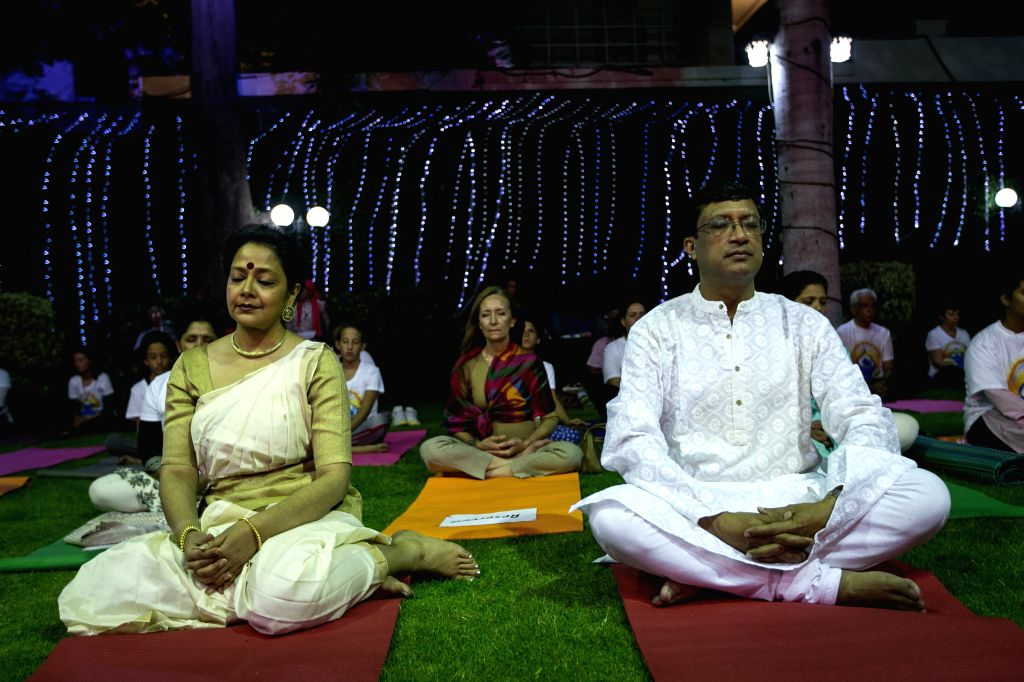 A couple from India practice Yoga to celebrate the first International Day of Yoga in Cairo, Egypt, June 21, 2015.