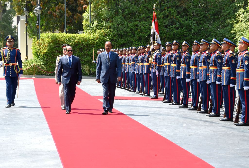 CAIRO, June 8, 2019 - Egyptian President Abdel-Fattah al-Sisi (central L) and Eritrean President Isaias Afwerki (central R) inspect the guard of honor in Cairo, Egypt, on June 8, 2019. Egyptian ...