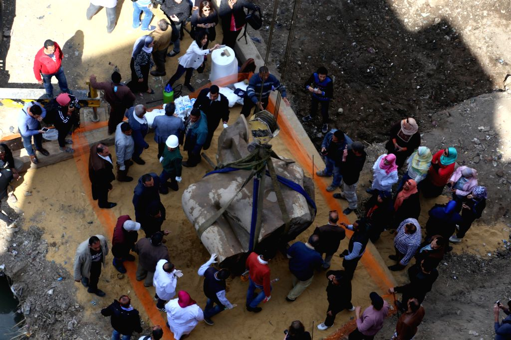 CAIRO, March 13, 2017 - Part of a 19th dynasty royal statue is lifted by Egyptian workers at the site of a new archeological discovery at Souq Al-Khamis district in Al-Matareya area, Cairo, Egypt on ...