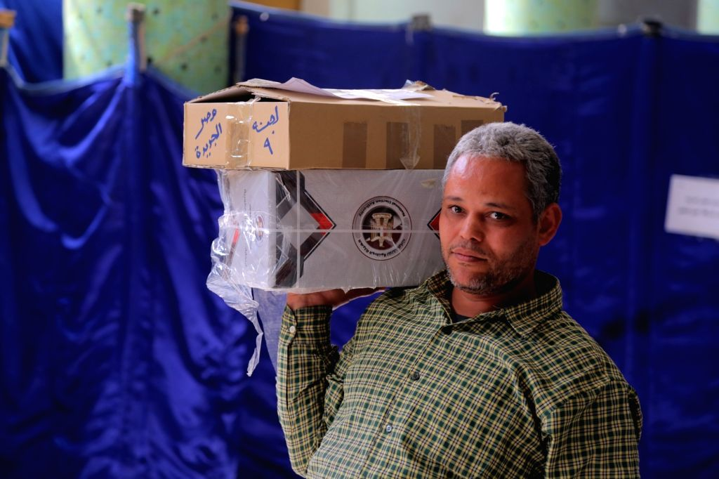 CAIRO, March 25, 2018 - An electoral worker distributes ballots for the upcoming presidential election at a polling station in Cairo, Egypt, on March 25, 2018. Egypt's 2018 presidential election will ...