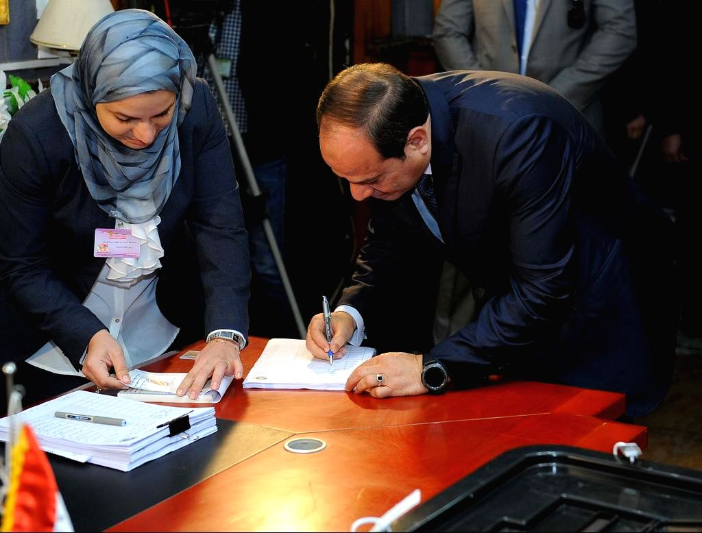 CAIRO, March 26, 2018 - Egyptian President Abdel-Fattah al-Sisi (R) prepares to cast his ballot at a polling station in Cairo, Egypt, on March 26, 2018. Voting of Egypt's presidential election began ...