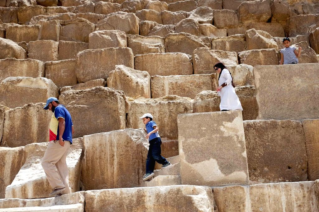 Tourists go down the steps at the Pyramids of Giza, Cairo, Egypt, May 10, 2014.