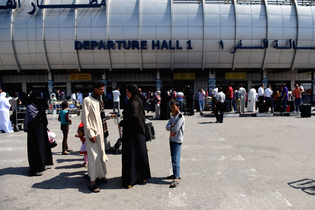 CAIRO, May 19, 2016 - Passengers are seen outside the Cairo International Airport, Egypt, May 19, 2016. A joint rescue team has been deployed to search for the EgyptAir flight which disappeared from ...