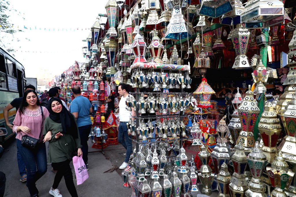 CAIRO, May 4, 2019 - Egyptians select traditional lanterns in a local market in Cairo, Egypt, May 3, 2019. Ahead of the Muslim holy month of Ramadan, customers flock to markets in the Egyptian ...