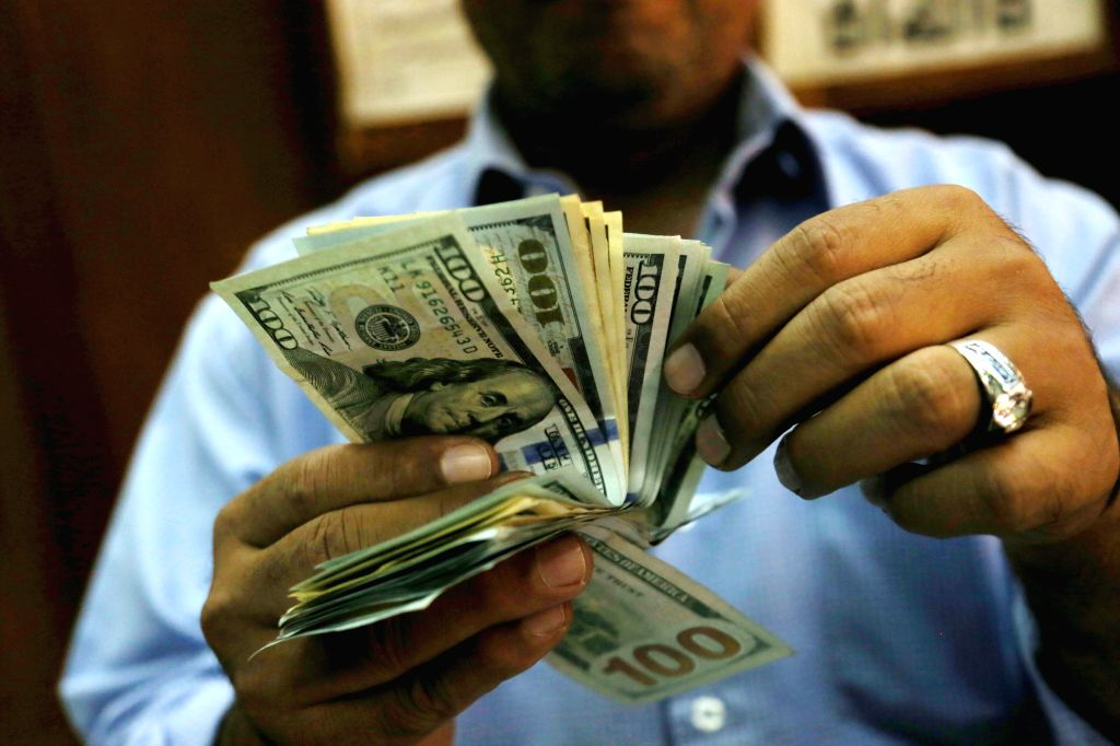 CAIRO, Nov. 12, 2016 - An employee counts money in a money exchange office in downtown Cairo, Egypt on Nov. 12, 2016. The International Monetary Fund (IMF) executive board approved on Friday Egypt's ...