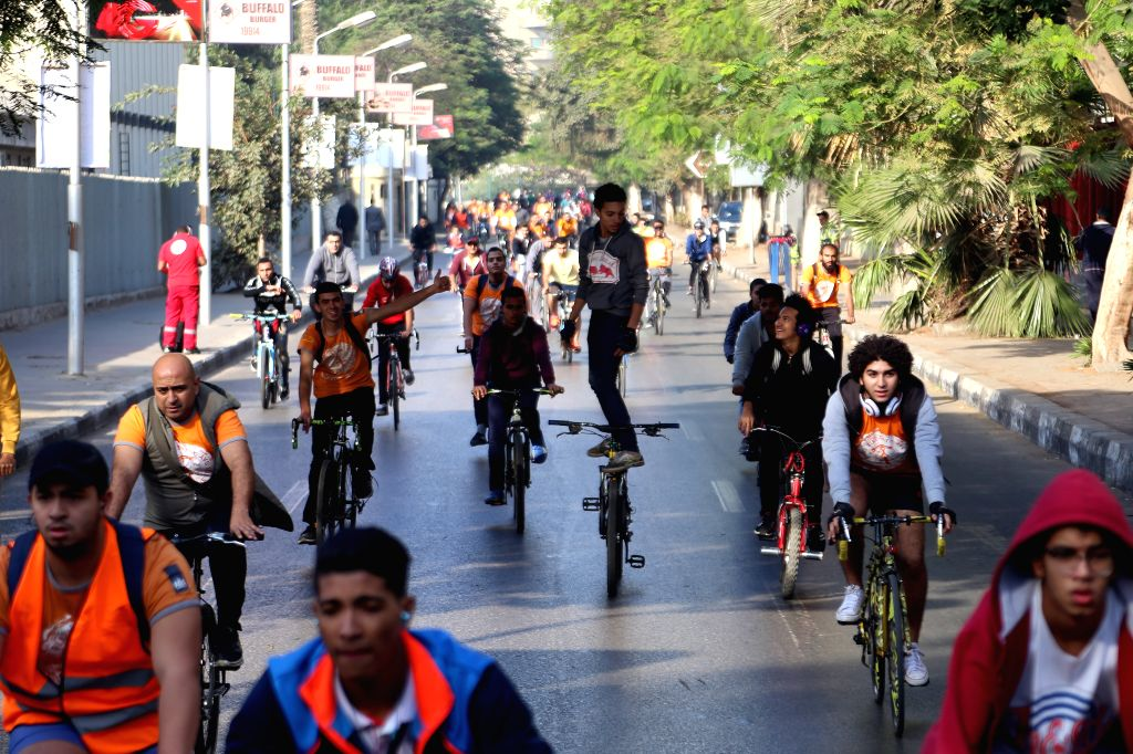 """CAIRO, Nov. 18, 2016 - People ride bikes during the """"Orange Bike Day"""" organized by the Netherlands Embassy in Cairo, Egypt, Nov. 18, 2016. The event was organized to draw the attention to ..."""