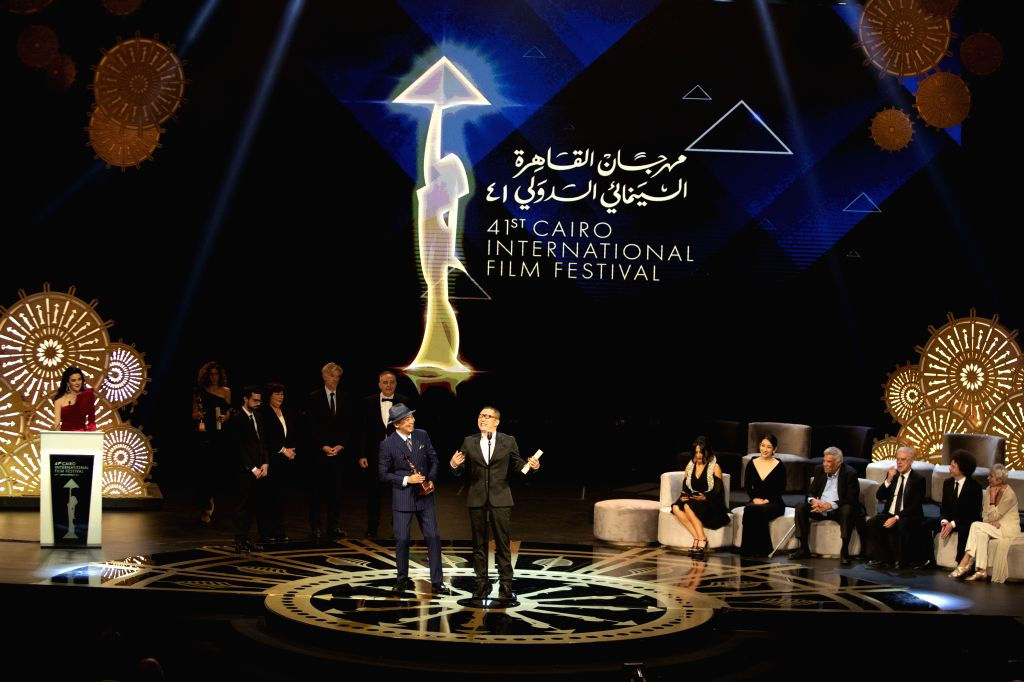 "CAIRO, Nov. 29, 2019 - Director Zhang Chong (front, L) and Zhang Bo (front, R) of Chinese movie ""The Fourth Wall"" attend the awarding ceremony of Cairo International Film Festival in Cairo, ..."