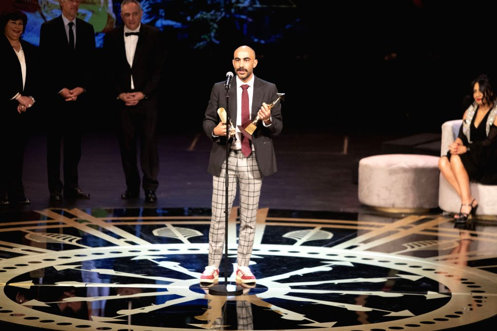 "CAIRO, Nov. 29, 2019 - Mexican filmmaker Fernando Frias (C), director of ""I'm No Longer Here"", speaks at the awarding ceremony of Cairo International Film Festival in Cairo, Egypt, on Nov. ..."