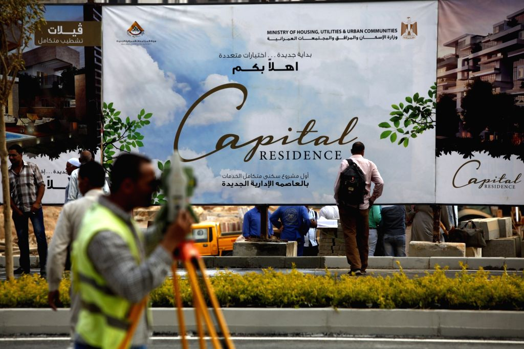 CAIRO, Oct. 14, 2017 - A billboard is seen at the construction site of the new Egyptian capital, 50km east of Cairo, Egypt, on Oct. 14, 2017. The new Egyptian capital construction, which is estimated ...