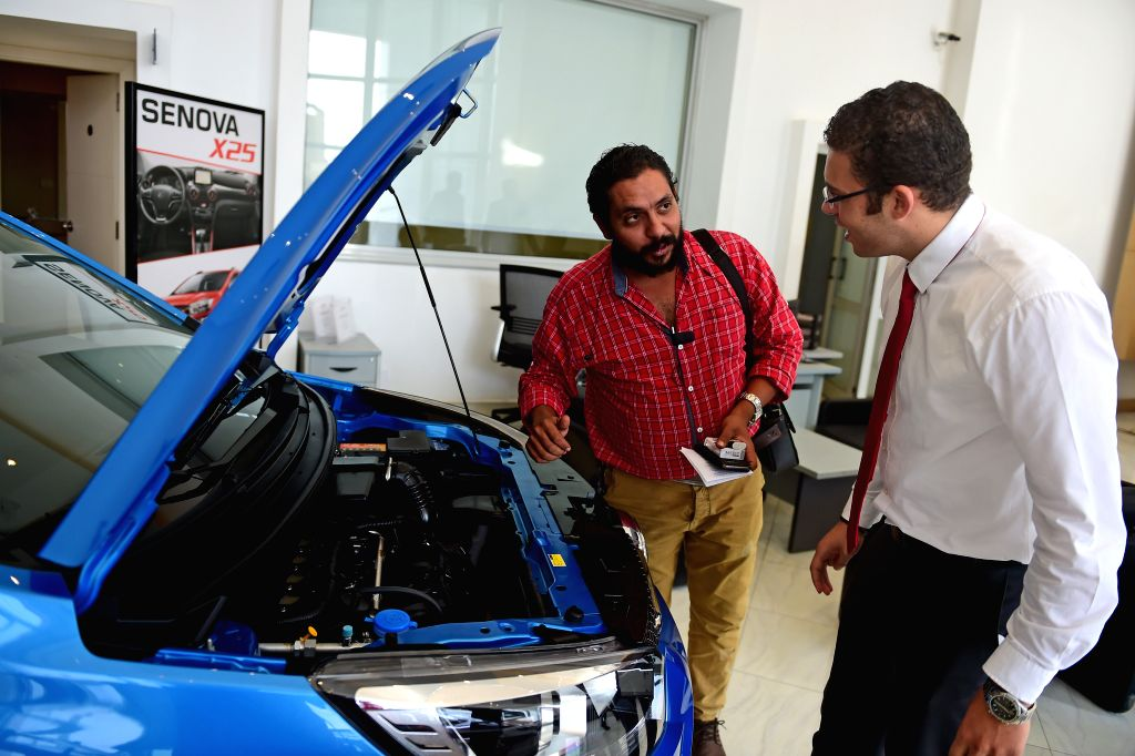 CAIRO, Oct. 27, 2016 - A customer(L) inquires about a Senova car in a service center of Senova, a vehicle type of the Beijing Automotive Industry Corporation (BAIC), on the outskirts of Cairo, ...