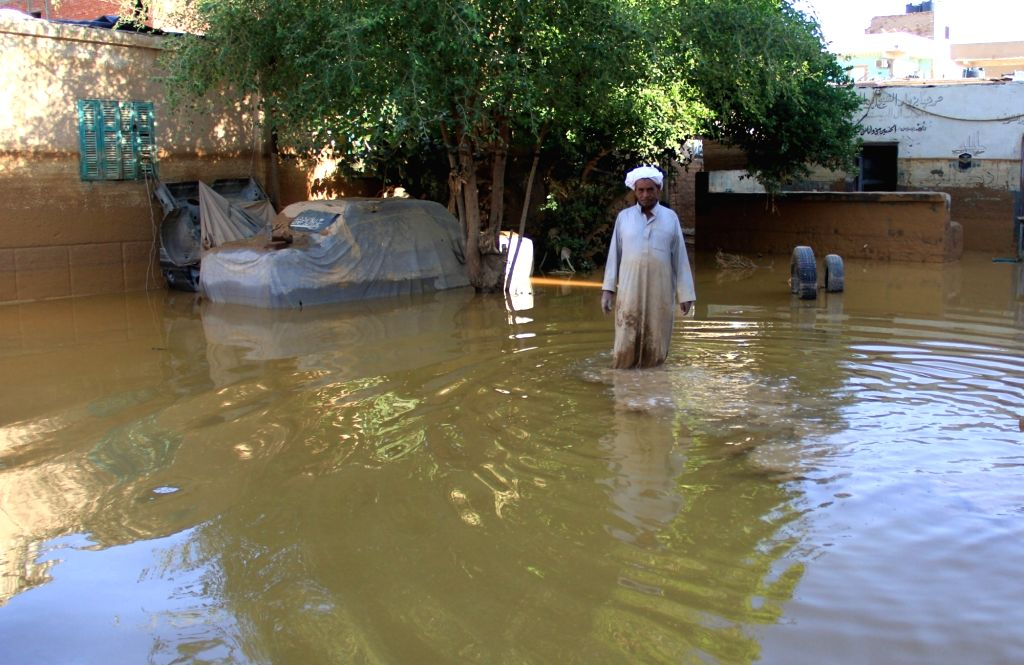 CAIRO, Oct. 29, 2016 - An Egyptian man stands at his flooded yard in Ras Gharib, Red Sea Province, Egypt on Oct. 29, 2016. The death toll of Egypt's massive floods since Thursday has risen to 26, the ...