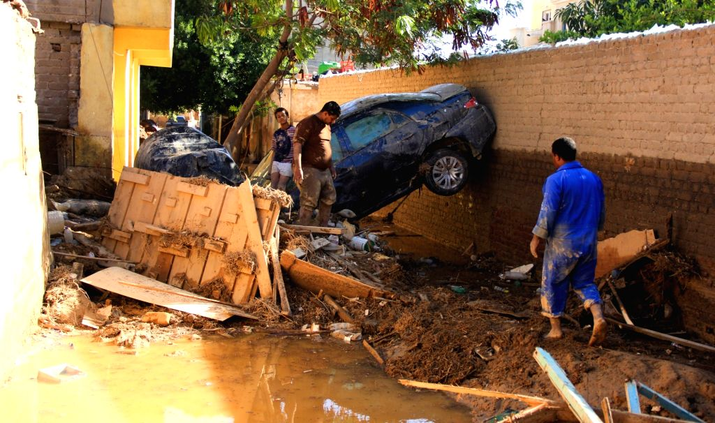 CAIRO, Oct. 29, 2016 - People salvage belongings from a destroyed house after flood in Ras Gharib, Red Sea Province, Egypt on Oct. 29, 2016. The death toll of Egypt's massive floods since Thursday ...