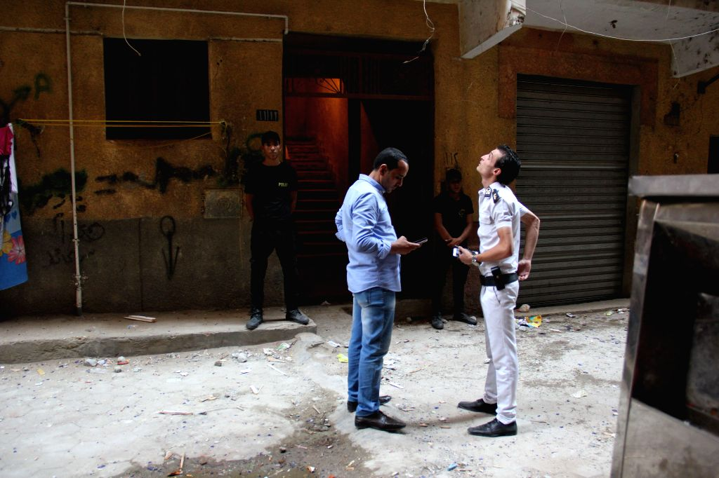 CAIRO, Sept. 10, 2017 - Egyptian policemen inspect the site of fire exchange with the militants in Giza's Ard al-Liwaa district, Egypt on Sept. 10, 2017. At least 10 terrorists were killed and nine ...