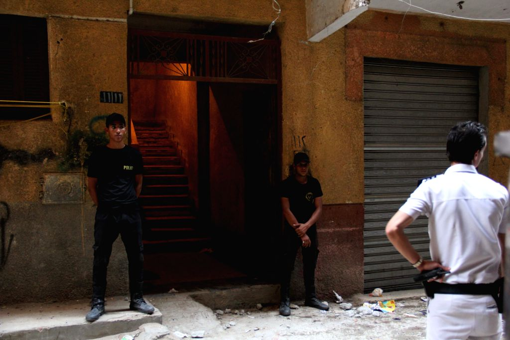 CAIRO, Sept. 10, 2017 - Egyptian policemen stand guard at the site of fire exchange with the militants in Giza's Ard al-Liwaa district, Egypt on Sept. 10, 2017. At least 10 terrorists were killed and ...