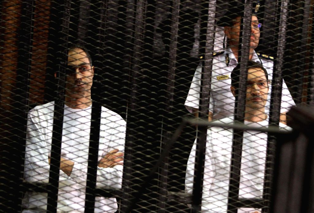 CAIRO, Sept. 16, 2018 - File photo taken on July, 9, 2012 shows Gamal Mubarak(L) and Alaa Mubarak(R front) are seen behind bars during a trial in Cairo. An Egyptian court ordered on Saturday the ...