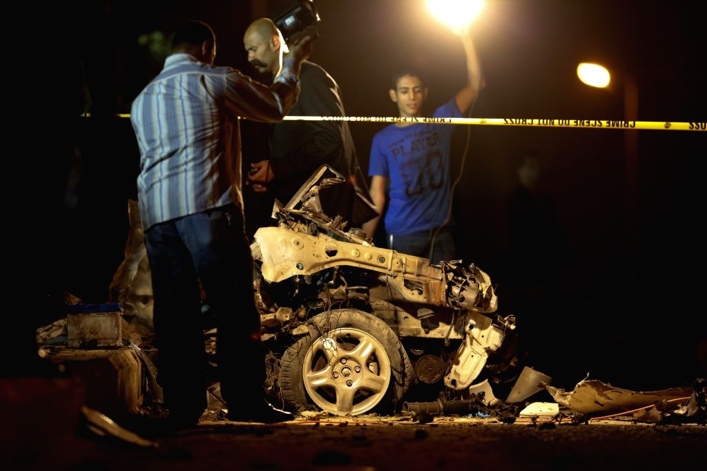 CAIRO, Sept. 29, 2016 - Egyptian security forces inspect the blast scene in New Cairo, Egypt on Sept. 29, 2016. Egypt's interior ministry said the car bomb exploded as the top prosecutor-general's ...