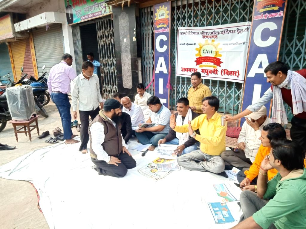 CAIT members sitting on dharna at a market at Madhubani in Darbhanga district during Bharat Bandh.