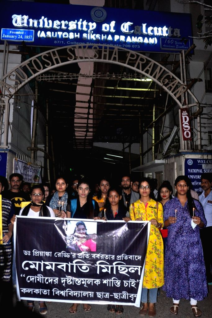 Calcutta University students participate in a candle march to protest against gruesome gang rape and murder of a woman veterinarian in Hyderabad; in Kolkata on Dec 3, 2019.