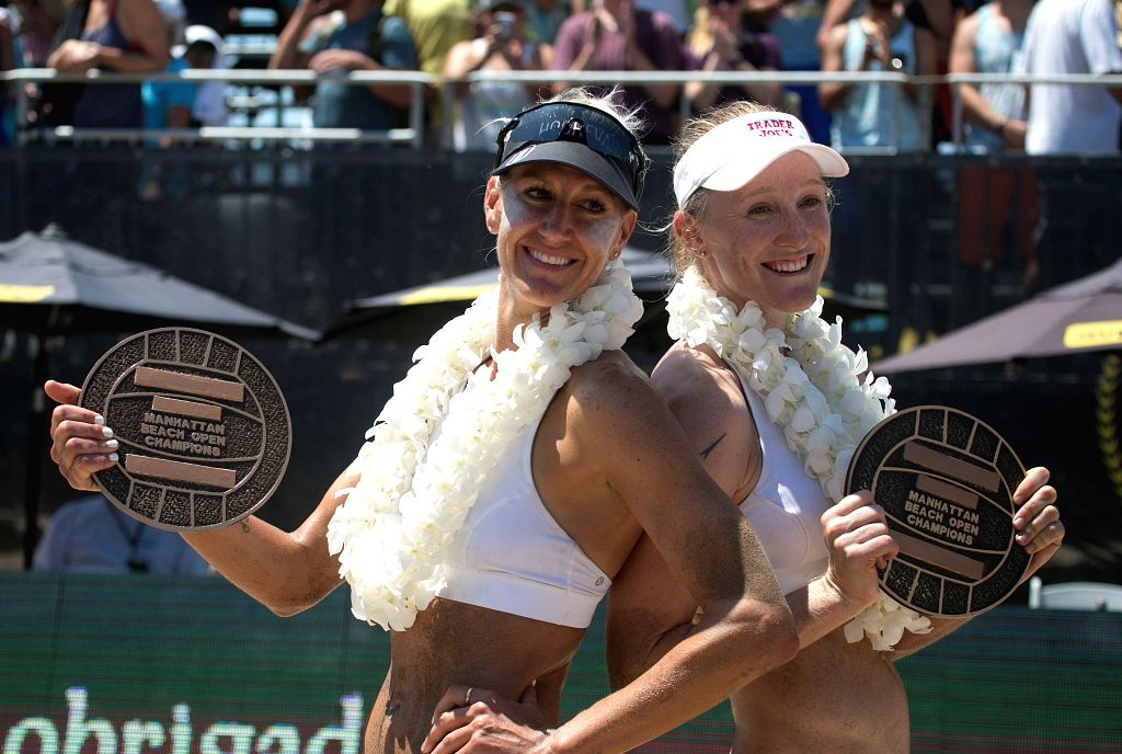 CALIFORNIA, Aug. 21, 2017 - Brittany Hochevar (L) and Emily Day celebrate after winning the Women's Finals of the 58th annual AVP Manhattan Beach Open in Manhattan Beach, California, the United ...