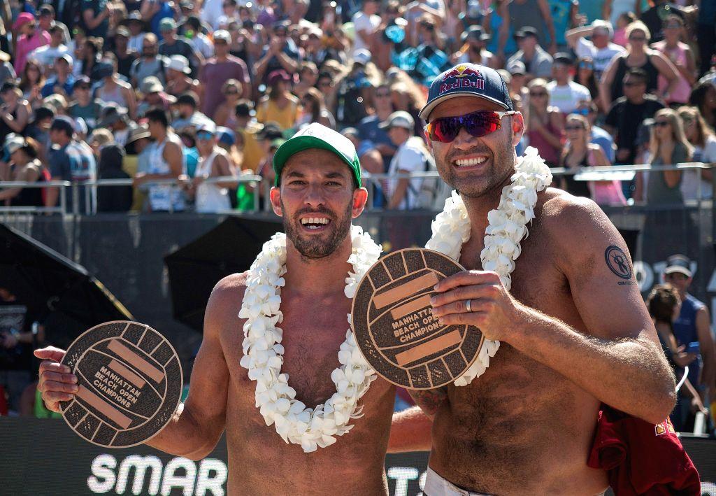 CALIFORNIA, Aug. 21, 2017 - Nick Lucena (L) and Phil Dalhausser celebrate after winning the Men's Finals the 58th annual AVP Manhattan Beach Open in Manhattan Beach, California, the United States, ...