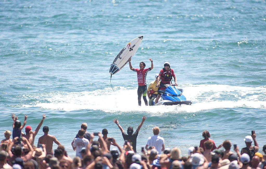 CALIFORNIA, Aug. 7, 2017 - Kanoa Igarashi of the U.S. celebrates after winning the Men's 2017 U.S. Open of Surfing Final in Huntington Beach, California, Aug. 6, 2017.