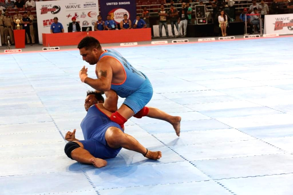 California Eagles player Balkar and Gurinder Pal of United Singhs in action during 9th match of the World Kabaddi League 2014 in New Delhi on Aug 23, 2014.