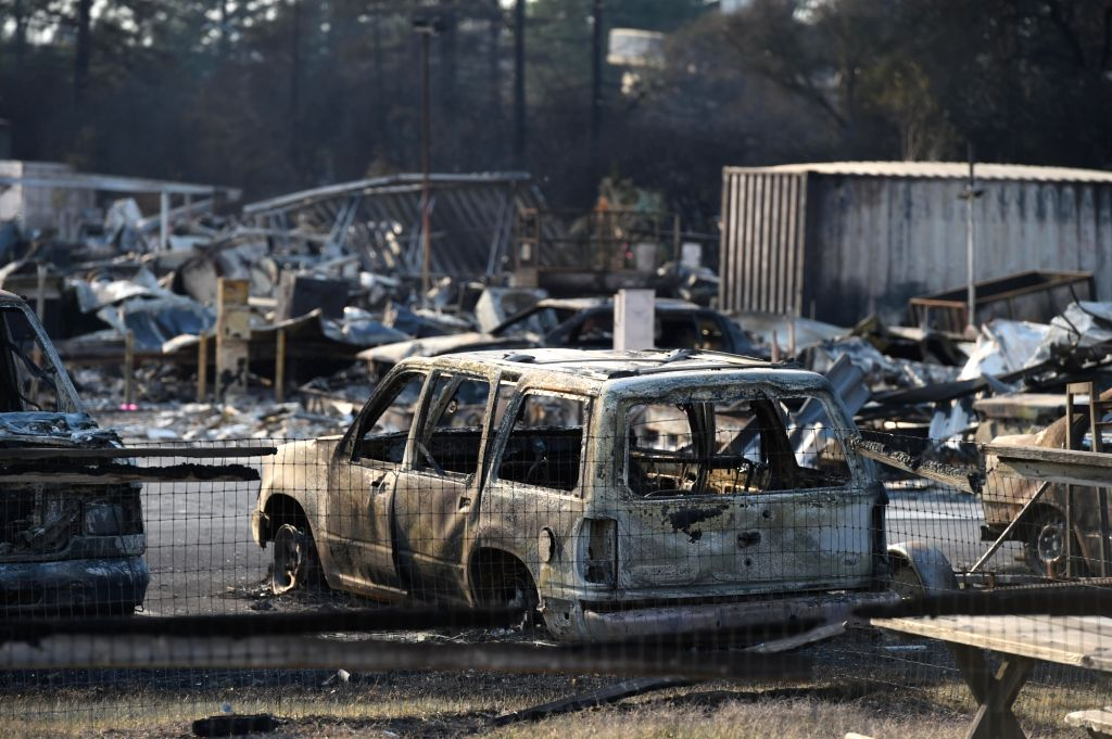 CALIFORNIA, Oct. 12, 2017 - Photo taken on Oct. 11, 2017 shows burnt cars and buildings in Santa Rosa, California, the United States. The number of dead has risen to 23 for all the wildfires sweeping ...