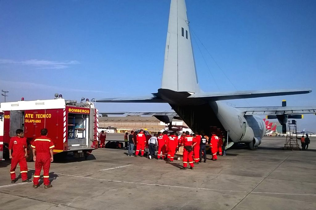 CALLAO, April 18, 2016 - Image provided by the Peruvian Defense Ministry shows members of the Urban Rescue Group (USAR Peru) of the General Corps of Volunteer Firefighters of Peru boarding an ...