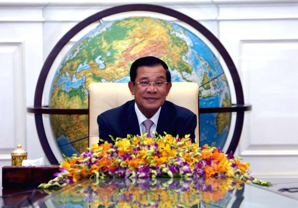 Cambodian Prime Minister Hun Sen reacts during a meeting with Chinese technicians in Phnom Penh, capital of Cambodia, on Nov. 27, 2015. Cambodian Prime Minister ... - Hun Sen