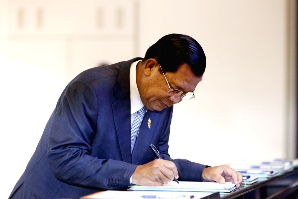 Cambodian Prime Minister Hun Sen registers his attendance at the National Assembly in Phnom Penh, Cambodia, Oct. 30, 2015. The National Assembly voted on Friday ... - Hun Sen
