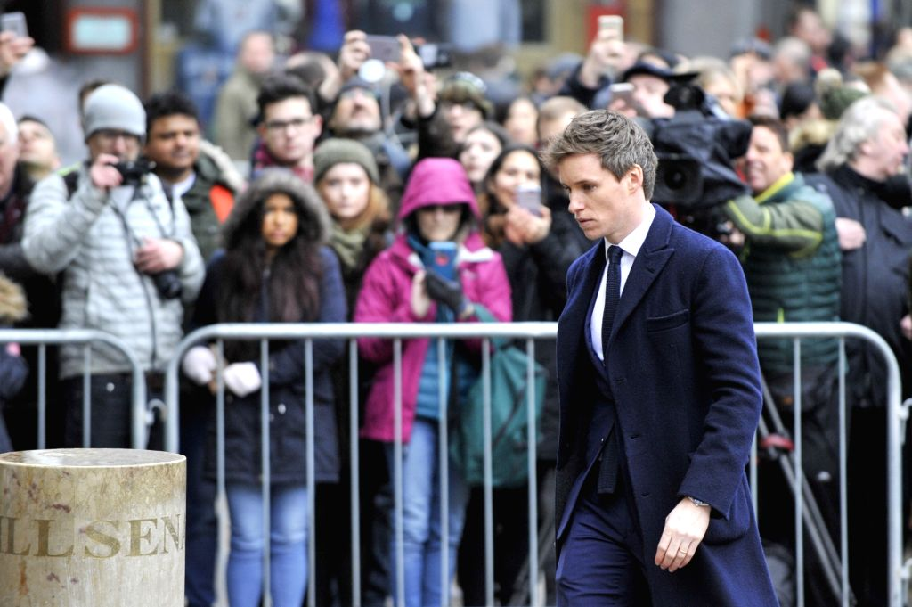 "CAMBRIDGE, March 31, 2018 (Xinhua) -- Actor Eddie Redmayne, who played the role of British physicist Stephen Hawking in the film ""The Theory of Everything"", attends the private funeral of Stephen Hawking at the Great St Mary's Church in Cambridge, Br - Eddie Redmayne"