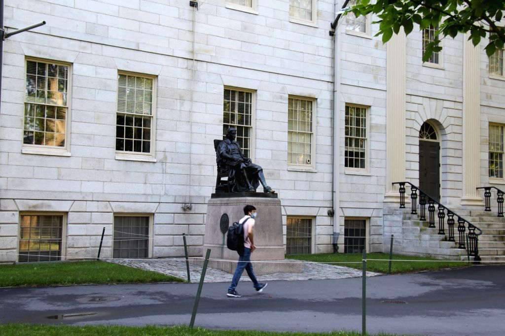 CAMBRIDGE (U.S.), July 14, 2020 A student walks on the campus of Harvard University in Cambridge of Massachusetts, the United States, on July 14, 2020. The U.S. government has rescinded a ...