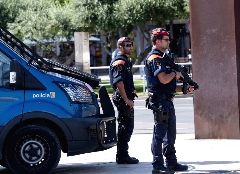 CAMBRILS (SPAIN), Aug. 18, 2017 Police officers stand guard near the beach in Cambrils, Spain, on Aug. 18, 2017. At least 14 died in Thursday's double terror attacks in Spain, as Spanish ...