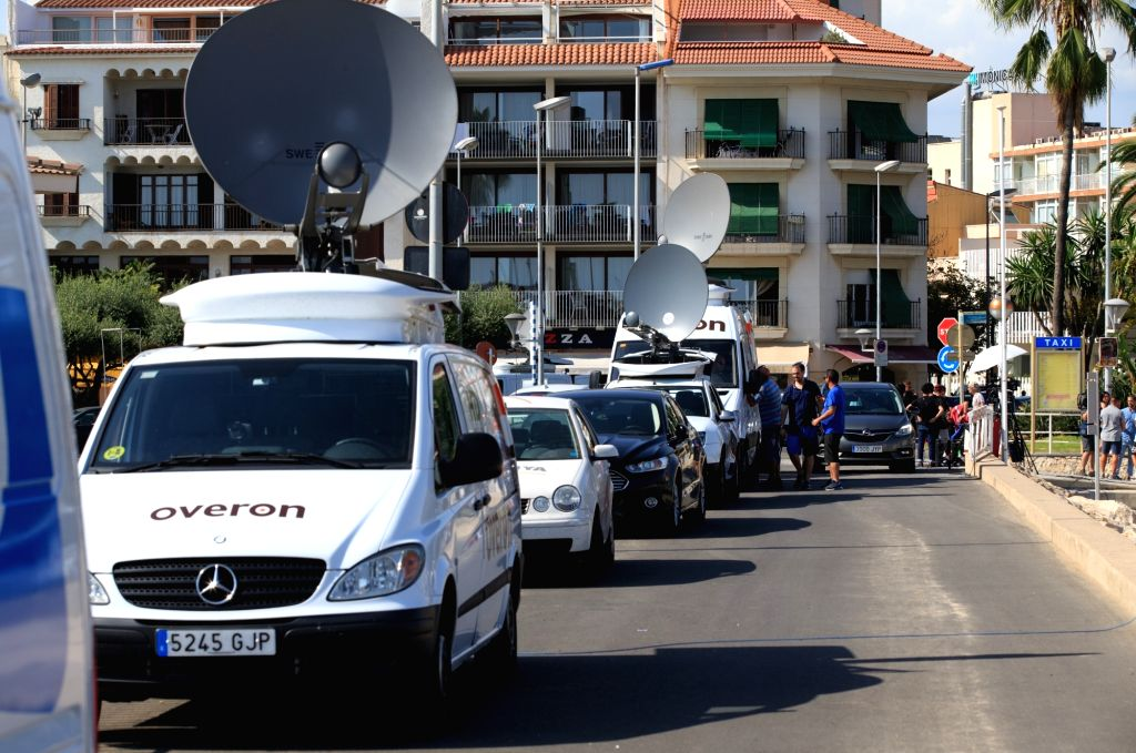 CAMBRILS (SPAIN), Aug. 18, 2017 Television vans are seen near the beach in Cambrils, Spain, on Aug. 18, 2017. At least 14 died in Thursday's double terror attacks in Spain, as Spanish ...