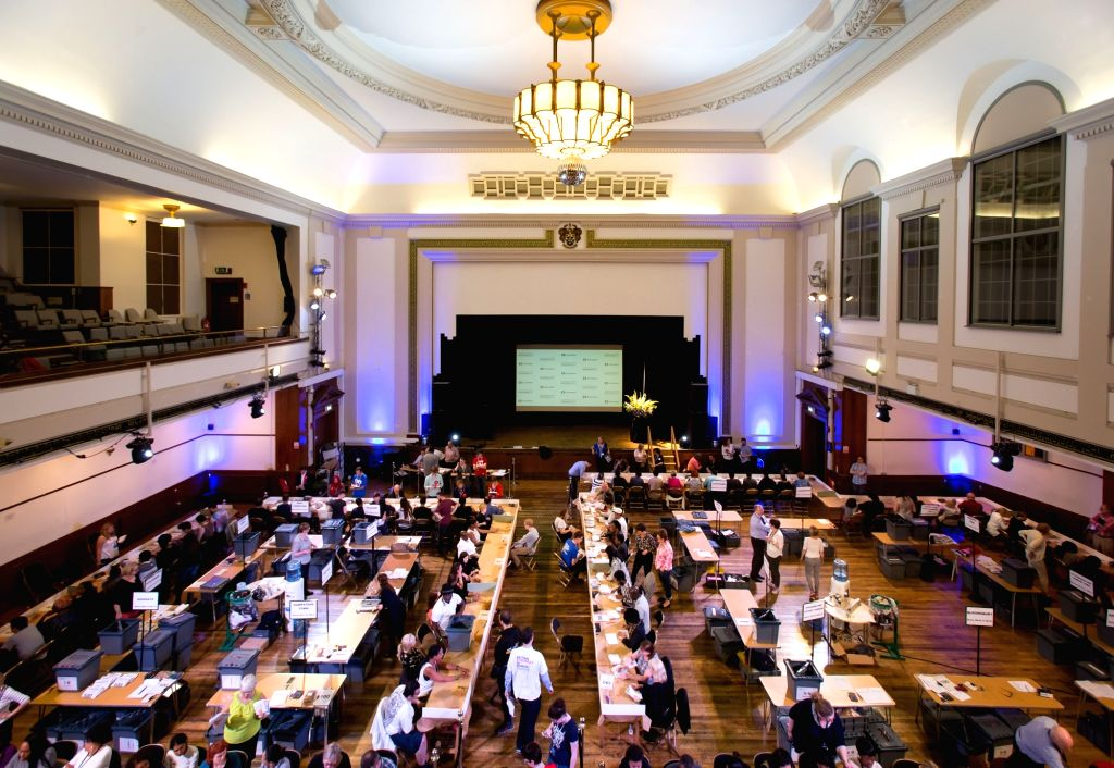CAMDEN, June 24, 2016 - Photo taken on June 24, 2016 shows a general view of the Camden Centre Town Hall where people count the ballot votes in Camden, Britain. Sky News says official results showed ...