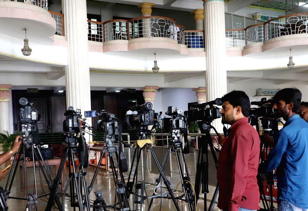 Cameras mounted on tripods parked behind the barricades put up at Karnataka Assembly, in Bengaluru on Oct 10, 2019. Speaker Vishweshwar Hegde Kageri banned national and regional private ... - Vishweshwar Hegde Kageri