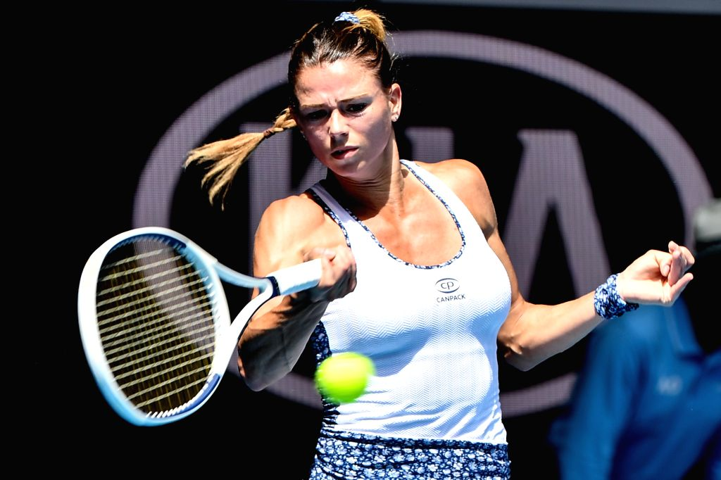 Camila Giorgi of Italy returns the ball during the women's singles third round match against Angelique Kerber of Germany at the 2020 Australian Open tennis ...